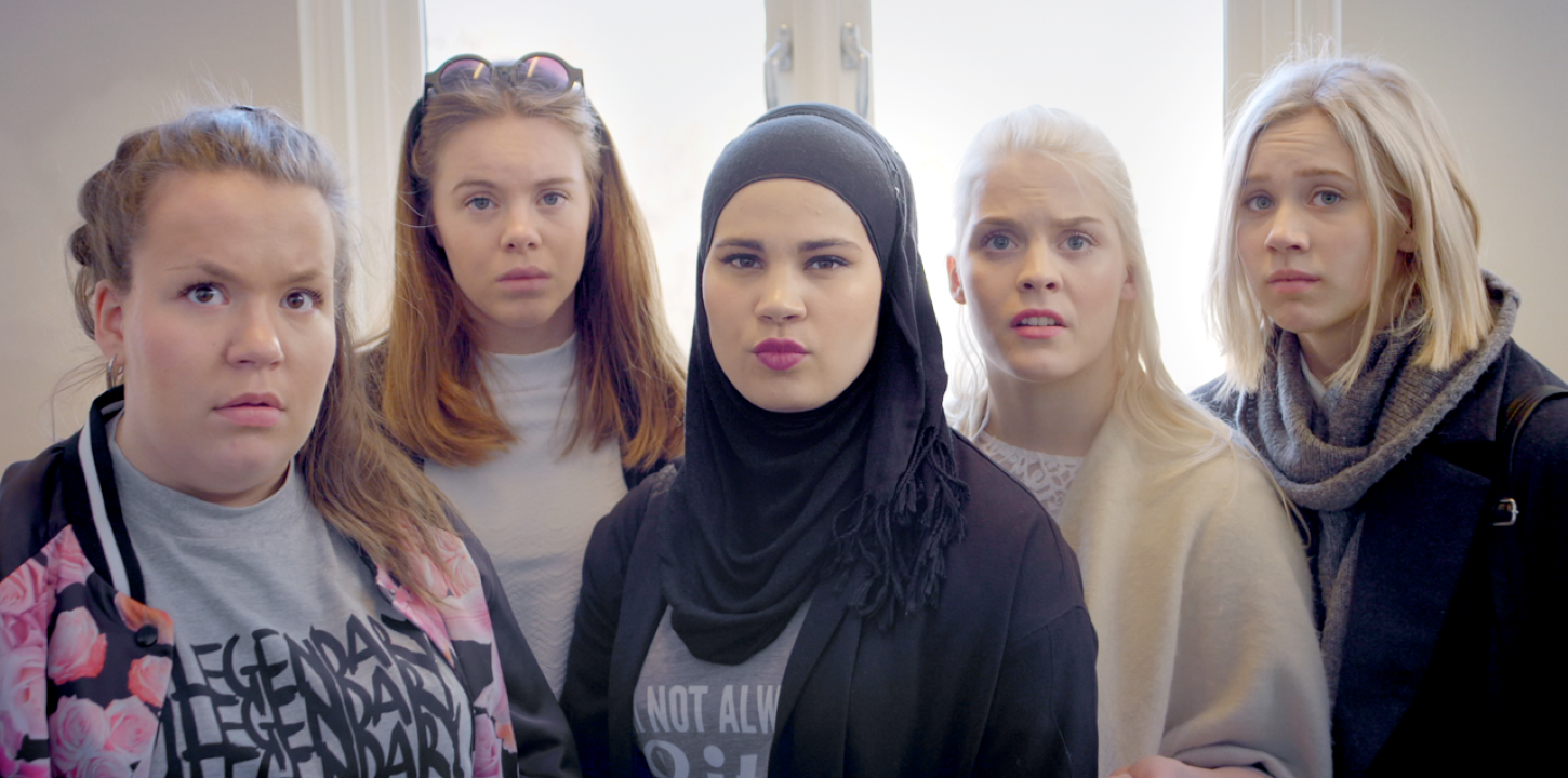 Close-up of five young women, with worried expressions.