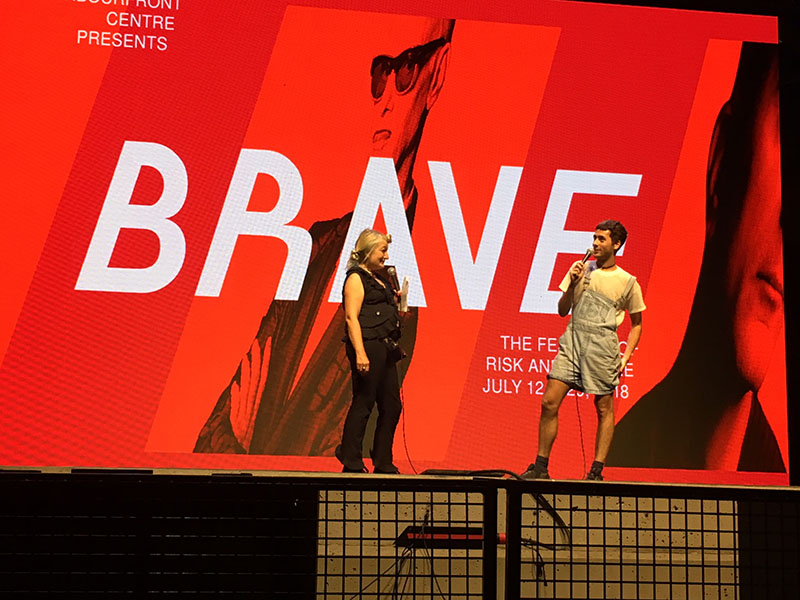 A woman and man in a live post-event conversation onstage