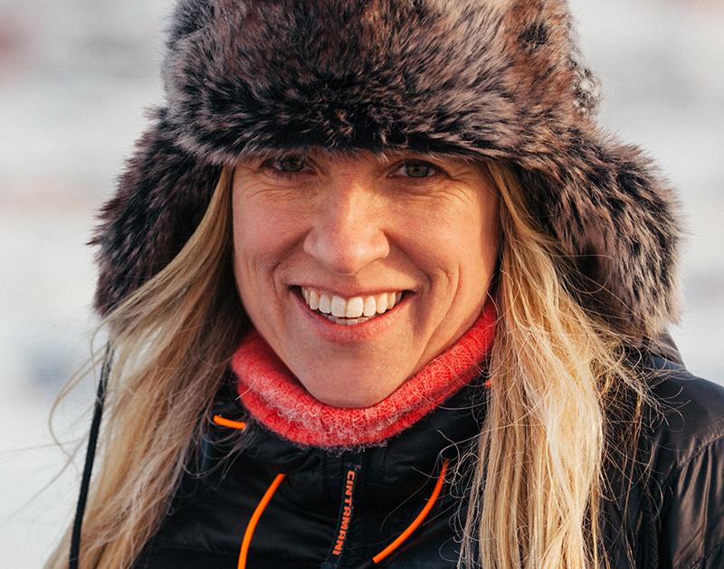 A woman wearing a fur cap in closeup.