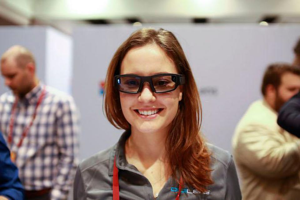 A headshot of a woman wearing smart glasses.