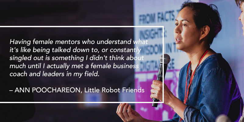 A woman talking into a microphone. Text overlaying the image reads: Having female mentors who understand what it's like being talked down to, or constantly singled out is something I didn't think about much until I actually met a female business coach and leaders in my field. – ANN POOCHAREON, Little Robot Friends