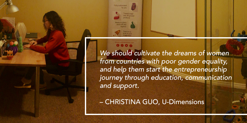 A woman sitting at a desk, using her laptop. Text overlaying the image reads: We should cultivate the dreams of women from countries with poor gender equality, and help them start the entrepreneurship journey through education, communication and support. – CHRISTINA GUO, U-Dimensions