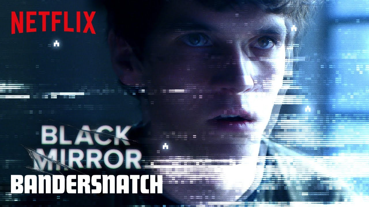 A headshot of a man with an overlay of a static screen texture. In the corner of the image the text reads: Black Mirror - Bandersnatch