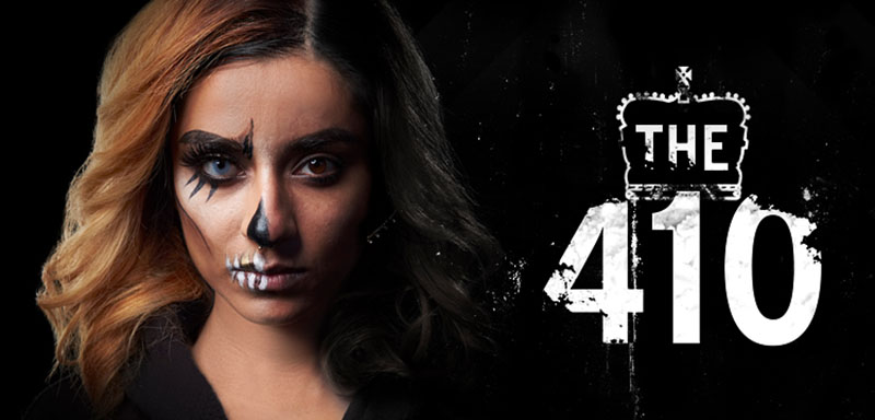 "A woman with her face half-painted and ""The 410"" on right side against a black background."