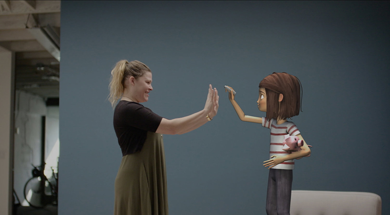 "A woman holds up her hands and interacts with a ""virtual being"""