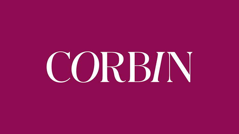 "Company logo - the name ""CORBIN"" written in white on a pink background"