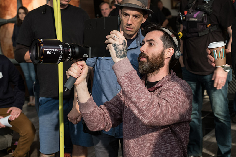 A film director holding a camera on set