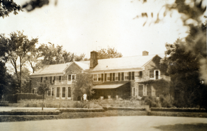 An old black and white photo of a Georgian Revival-style mansion.