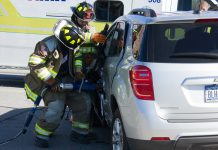 Forks firefighters use the Jaws of Life to pry open a door at a May 9, 2017 crash on Broadway. (Jim Herr/Cheektowaga Chronicle)