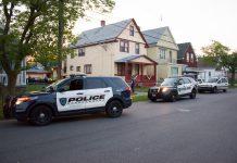 Cheektowaga Police officers check a yard on Edison Avenue in Buffalo after a short vehicle pursuit Tuesday night. (Jim Herr/Cheektowaga Chronicle)