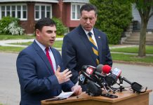 At the podium, Erie County Legislator Peter Savage, III and Erie County District Attorney John Flynn push to have state law changed to allow stiffer penalties for car poppers. May 24, 2017. (Jim Herr/Cheektowaga Chronicle)