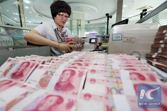Yuan slide reverses on buoyant GDP