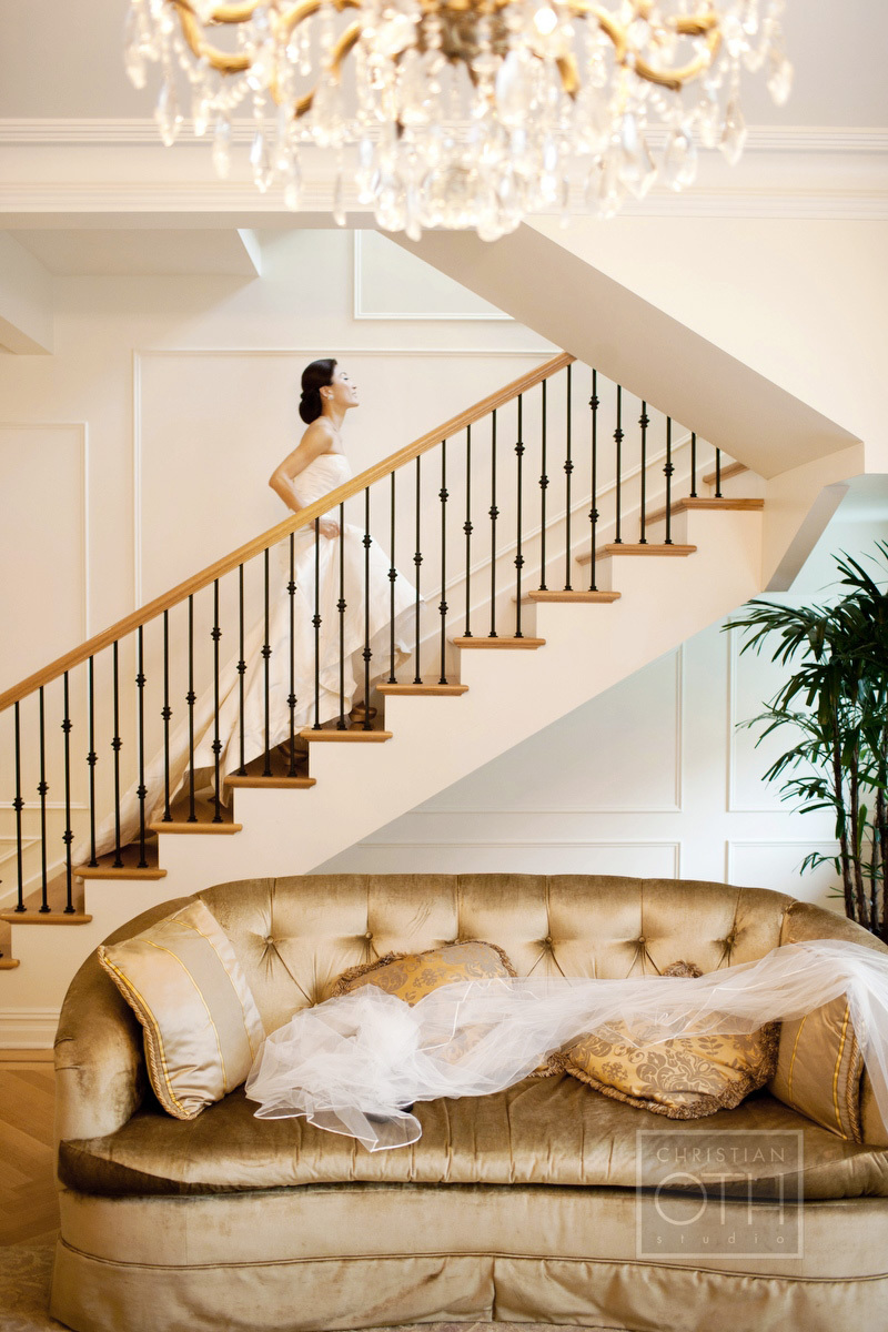 Bride walking up stairs at the Terrace Suite at  The Plaza in New York - Shawn Connell of Christian Oth Studio