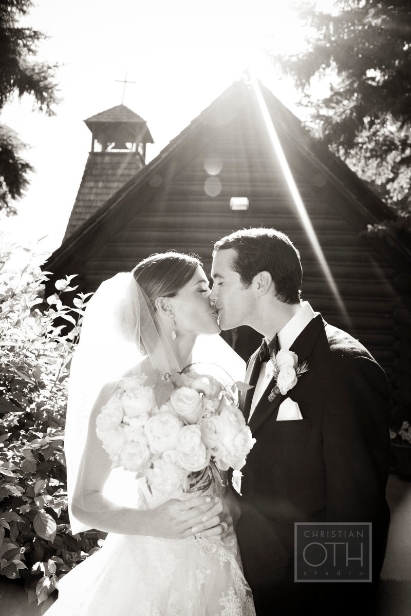 Bride and groom after their wedding ceremony in front of St Johns Episcopal church in Jackson Hole, WY - Christian Oth of Christian Oth Studio