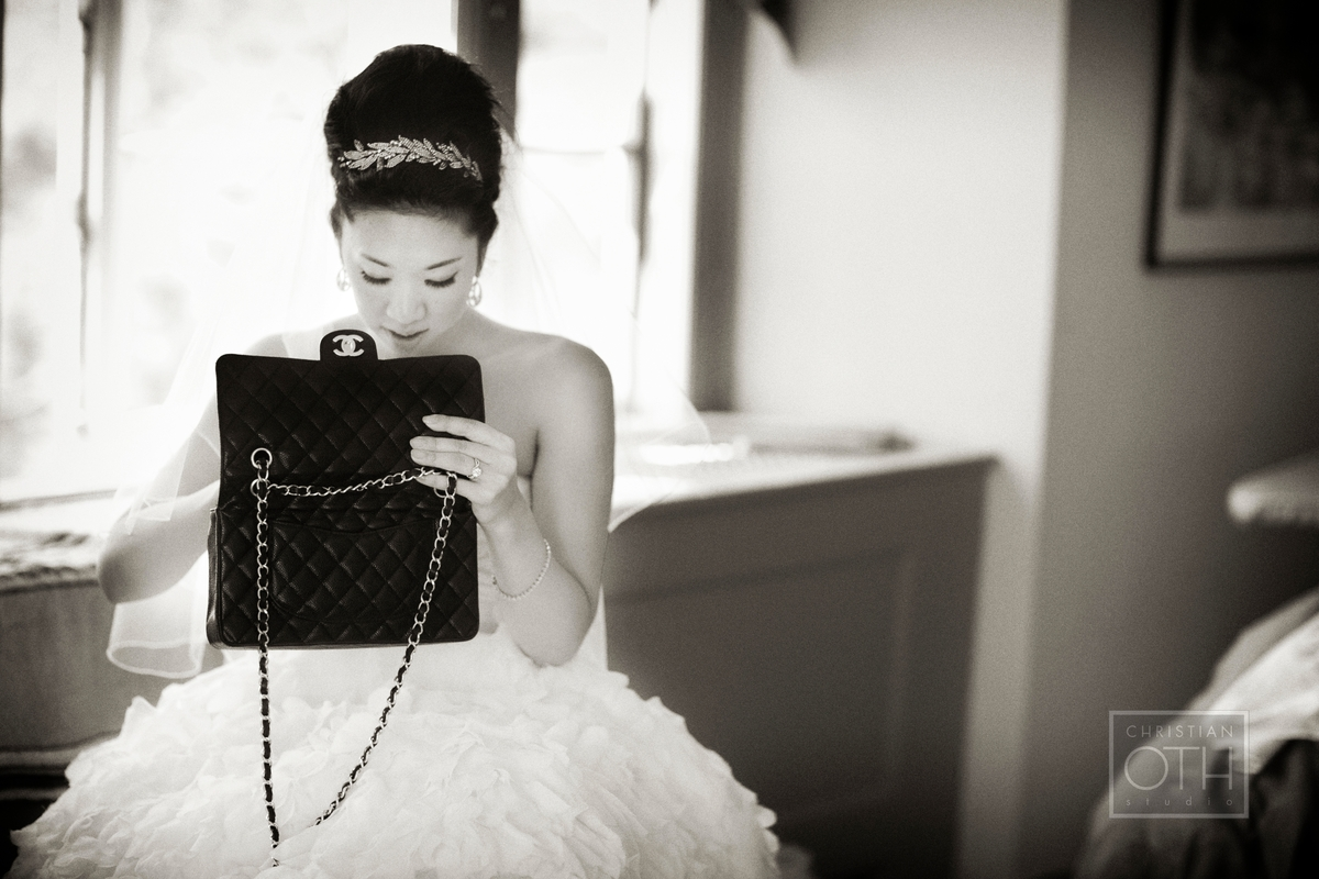 Bride with purse at Hudson Valley wedding at Cat Rock in Garrison, NY  - Glen Allsop of Christian Oth Studio