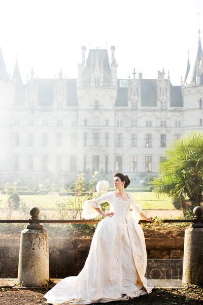 bride posing in front of chateau  - Shawn Connell of Christian Oth Studio