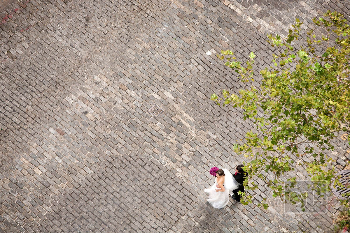 bride and groom from above on cobblestone - Christian Oth of Christian Oth Studio