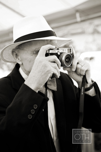 man with hat and camera - Christian Oth of Christian Oth Studio