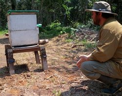 Prof. German Perilla and one of his bee hives