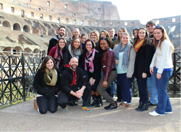 Psychology study abroad students pose in the Coliseum in Rome with Dr. Rebecca Morse.