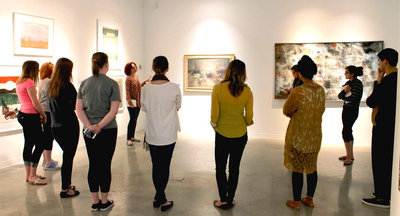 "A student leads a gallery talk of the ""Evoking Place"" exhibition"