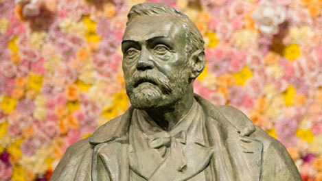 Alfred nobel bust with flowers 50