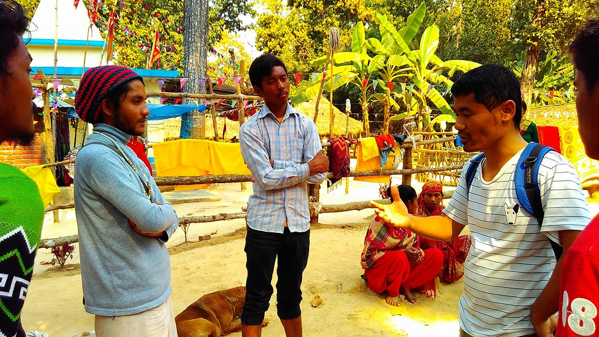 Proclaming gospel to a Hindu priest and group of people