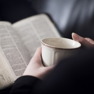 woman-holding-coffee-cup-with-Bible-open-300x300