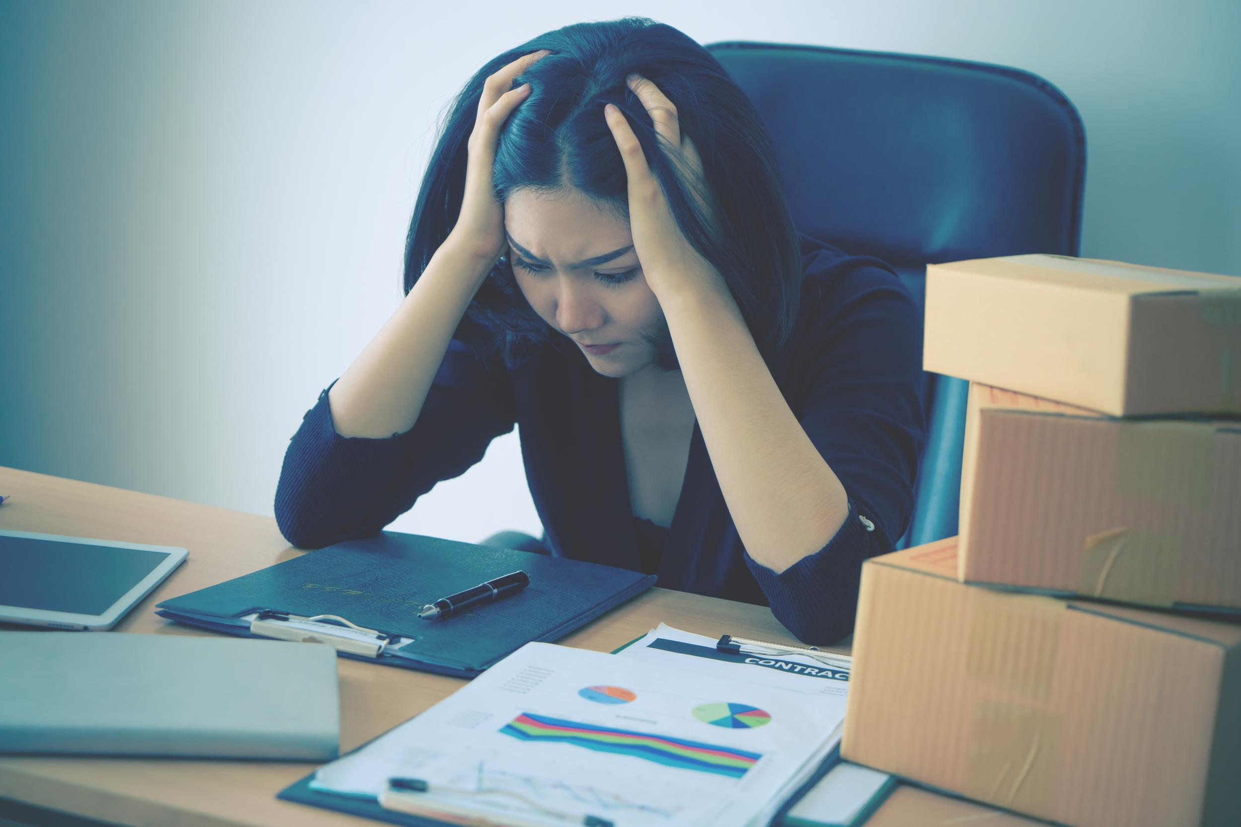 Start up business woman is stressing out on sale report for her start up business