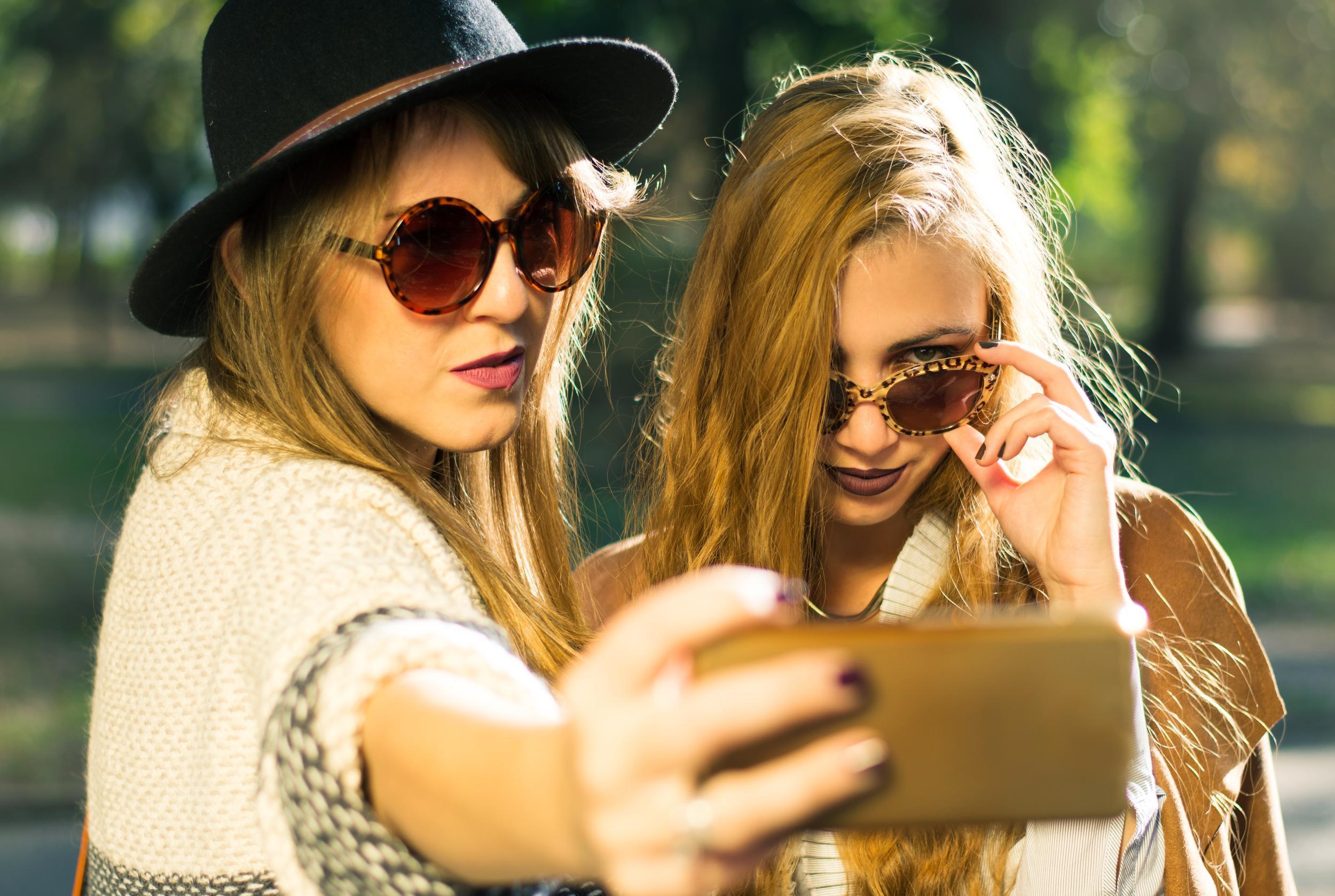 Friends taking selfie in the park