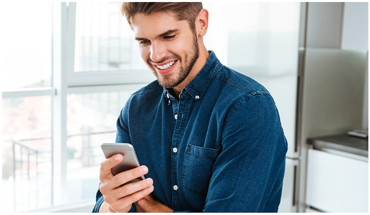 Guy looking at a cell phone