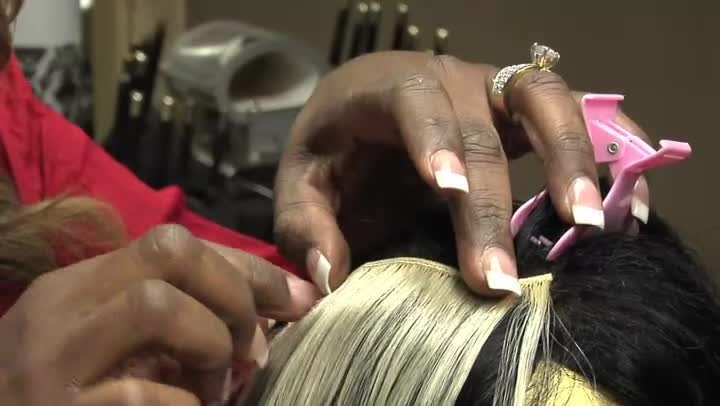 Video: How to Put Glue in Hair Extension Bangs | eHow