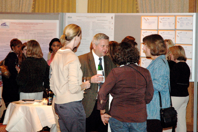 Guests mingle and discuss posters with presenters during the 2006 DLD Student Poster Session