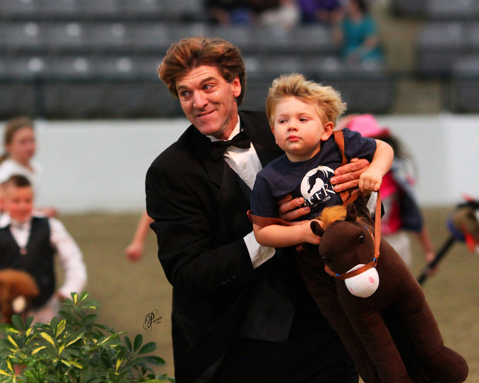 The 2015 Youth Stickhorse Class--Ringmaster Mike Frame carrying Brayden Jeffries over the finish line! Photo by Nancy Peirce