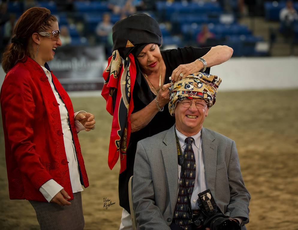 Judith Forbis and Lisa Abraham presenting Don Stine with a specially made turban! Photo by Victor Ricigliano