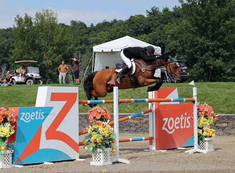 Kevin Babington jumps to his second  grand prix win at HITS Saugerties VI. Sunday's win came on Mark Q in the $100,000 Strongid© C 2X™ Grand Prix presented by Zoetis.