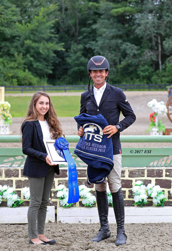 Roberto Teran accepting first prize in the $5,000 Devoucoux Hunter Prix from Erin Webb of HITS.