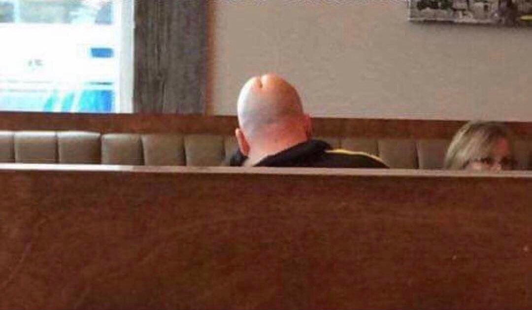 This fella knows that his head looks like a penis. It has his entire life.  You can't just meander into a local Denny's, ...