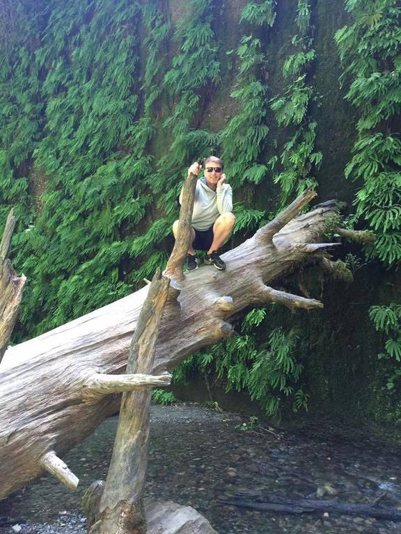 David on a tree stump at Fern Valley