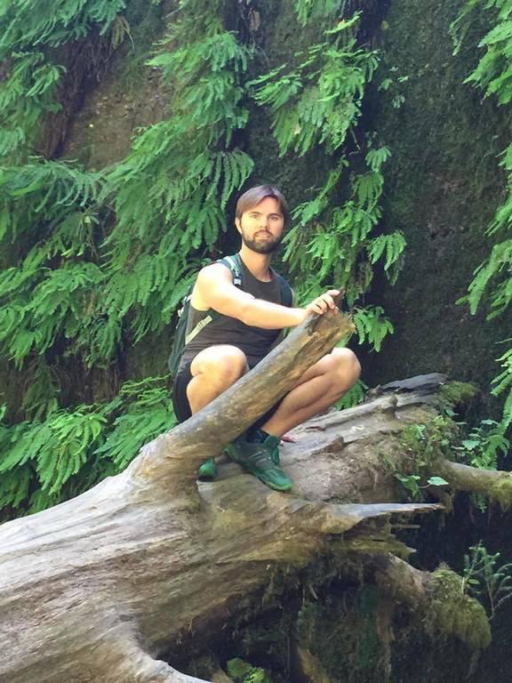 Zac on a tree stump at Fern Valley