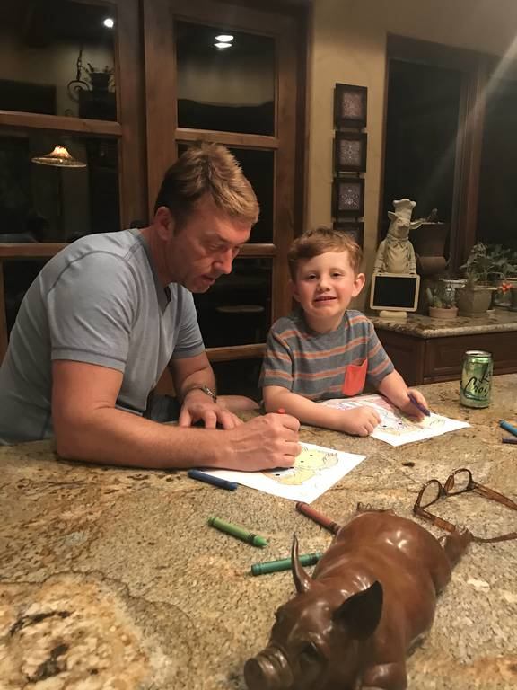 David & Chase coloring the first pages of the Chase's Kids Club Coloring Book