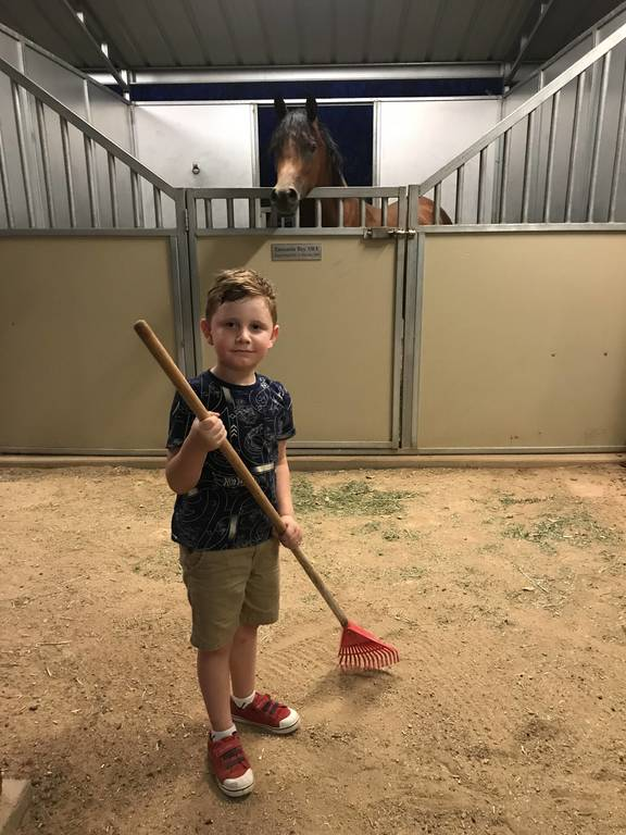 Chase cleaning up the barn a bit!