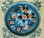 Photo of a Norwegian rosemaled wooden plate painted in the Valdres style by Pam Rucinski.