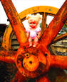 Doll & Rusty Wheel by Allan Goodman