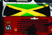 Jamaican flag above truck grille