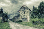 Barn_with_storm_clouds