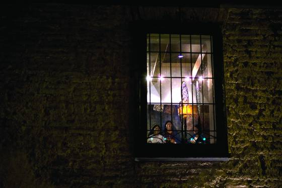 Three women in a window