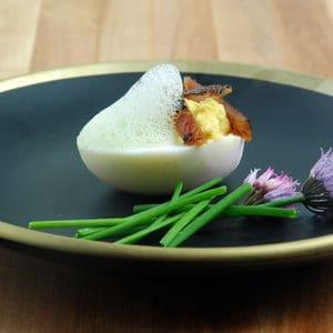 Devilled eggs chive foam bacon