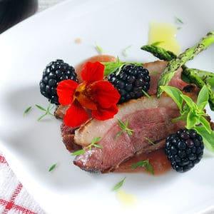 Sous vide duck blackberry port pudding
