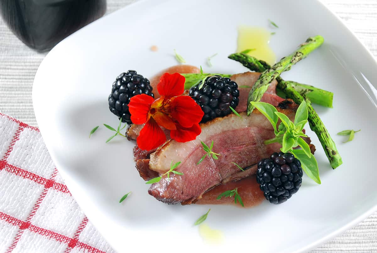 Sous vide duck blackberry port pudding